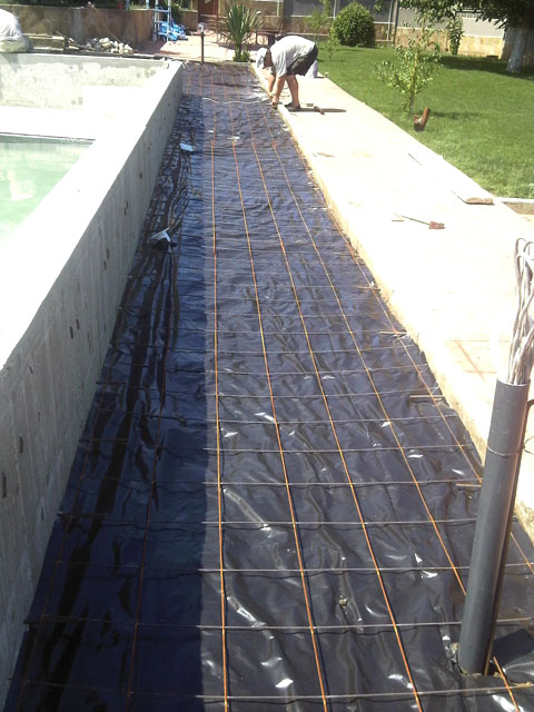 14-cover-the-ground-around-the-pool-with-plastic-and-reinforce-with-steel.jpg