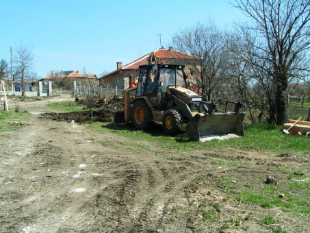 Excavator digging a hole for the inground concrete swimming pool in Bulgaria
