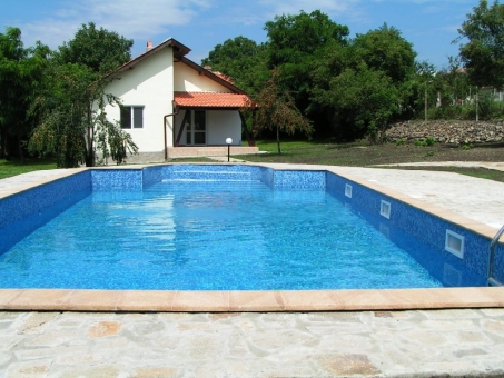 finished concrete swimming pool with sand filter - filled with water