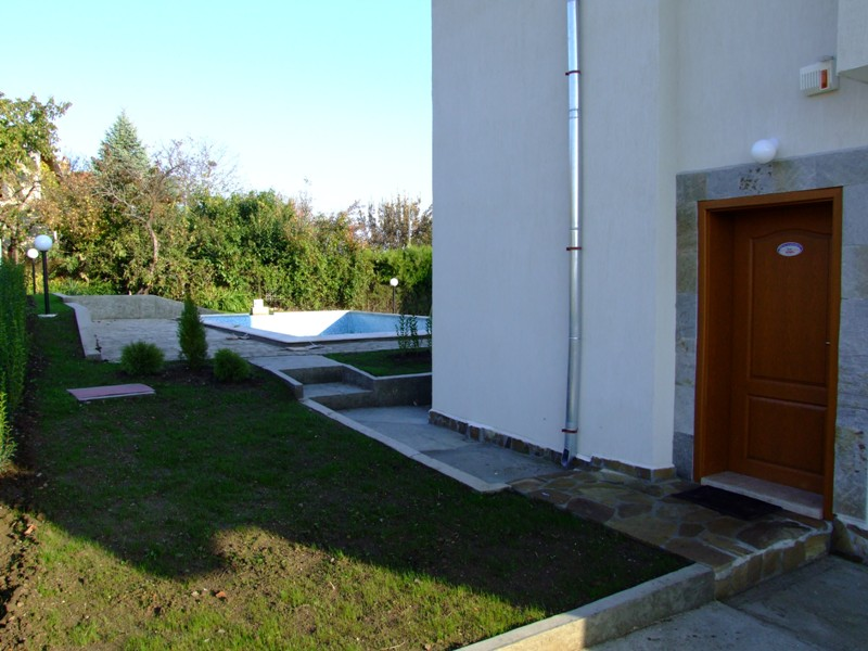 29 - View to the swimming pool. The garden is lanscaped - grass is growing.