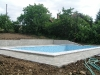 23 -   Swimming pool is tiled. Water can be filled in.