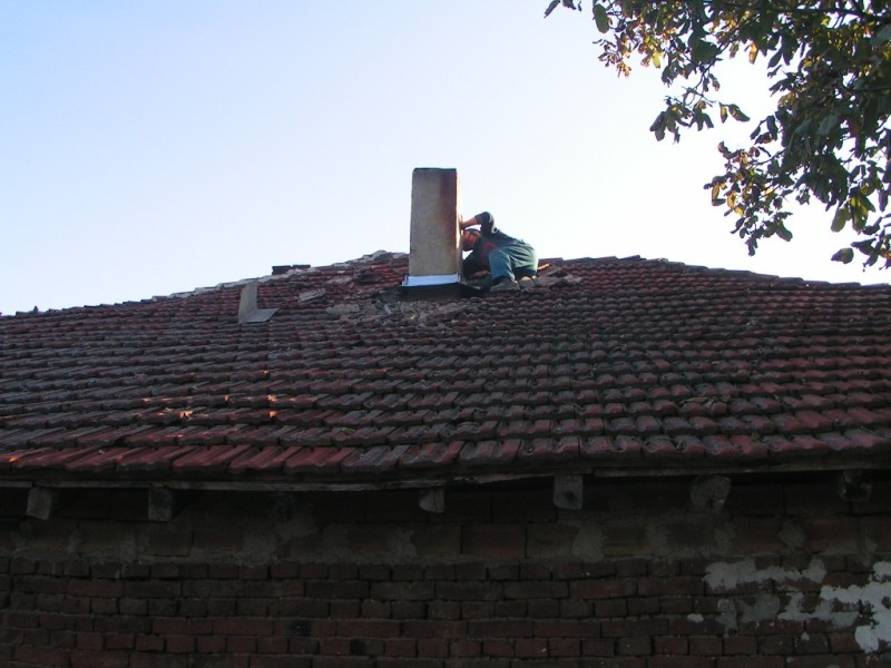 Removal of the leak by the chimney with new sheet metal flashing
